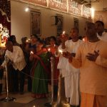 Devotees offering lamps to Lord Damodara