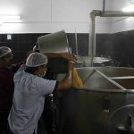 Loading of Dal to Cauldrons for preparing Sambhar